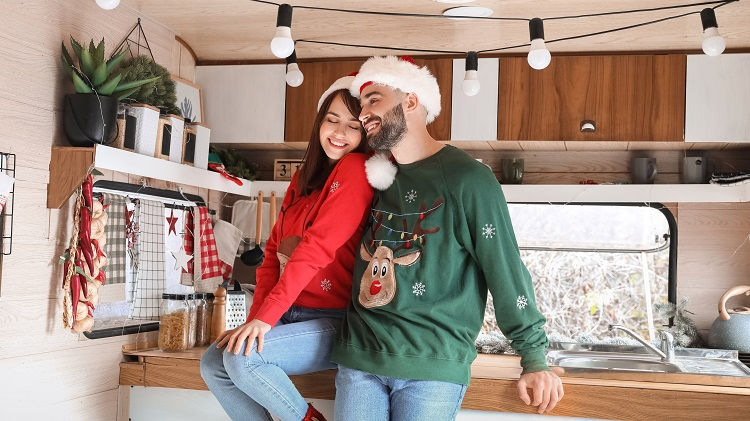 Happy couple in motorhome on Christmas eve
